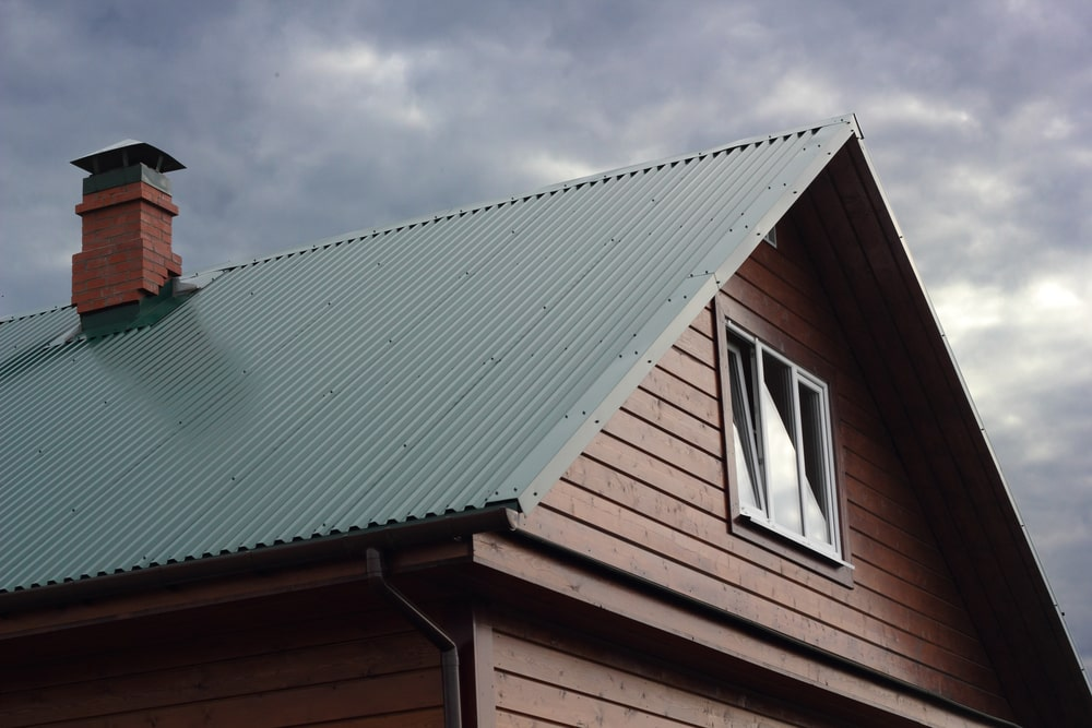 Green Metal Roof Under Cloudy Sky