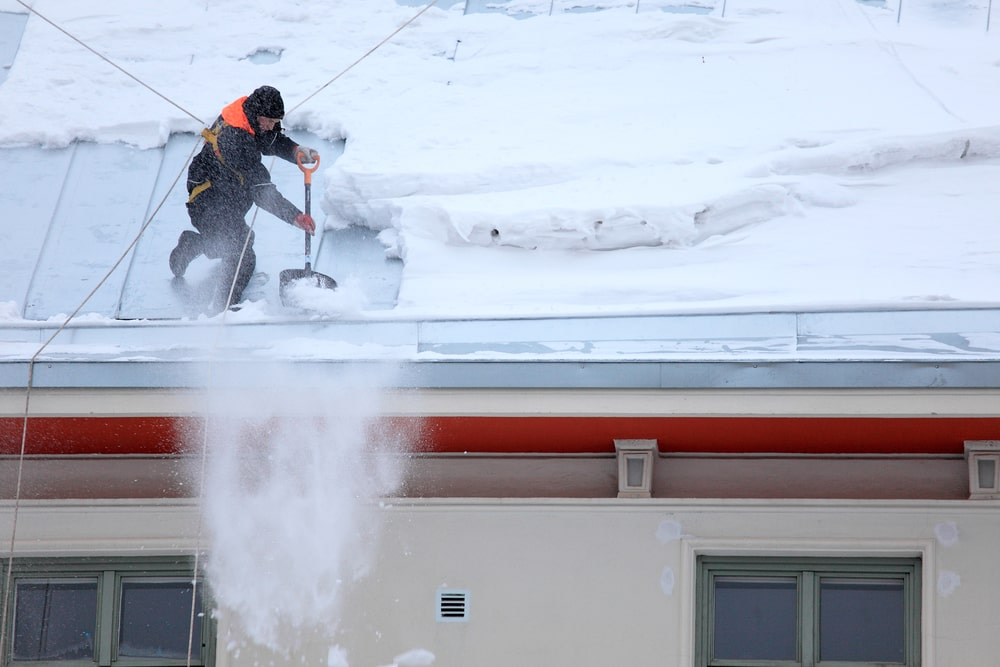 Pocatello roofing contractor working on snowy roof